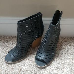Black block heel booties with open toe.